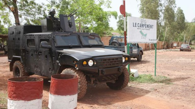 A Malian police officer stationed on an armoured personnel vehicle outside Campement Kangaba, Bamako.