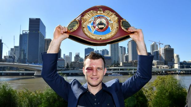 Jeff Horn proudly displays his WBO welterweight champion's belt in Brisbane after beating Manny Pacquiao.