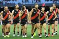 The Bombers make their way from the ground after the Round 15 AFL match between the Essendon Bombers and Brisbane Lions ...