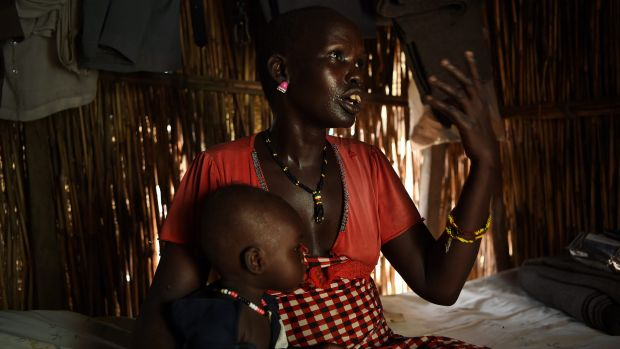 Keeping malnutrition at bay is  a major problem for mothers and their children, such as Martha Nyambol, 28, and her ...