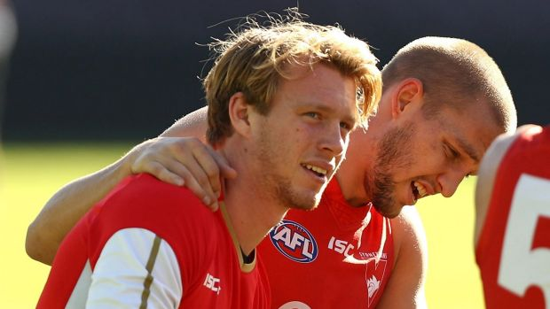 Hurdles remain: Callum Mills (left) was only able to participate in light training with the Swans on Tuesday.