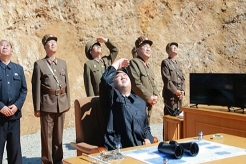 A video of a news bulletin aired by North Korea's KRT shows what was said to be North Korea leader Kim Jong-un (centre) ...