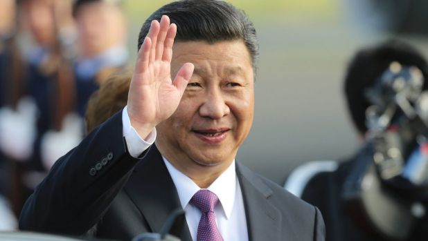 China's President Xi Jinping waves after arriving in Germany for the G20 summit.