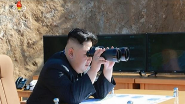 North Korea's KRT  shows what was said to be North Korean leader Kim Jong-un watching the launch of a Hwasong-14 ...