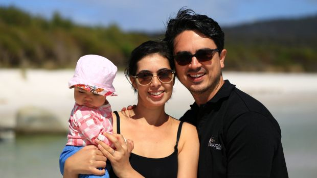 Andrew and Sophie Courtney with their daughter on holiday in Tasmania.