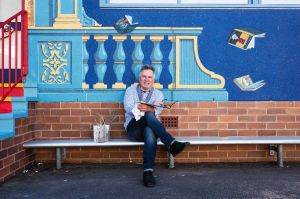 Portrait of French mural artist Hugues Sineux with his latest mural, a classroom at Epping Heights Public School. ...