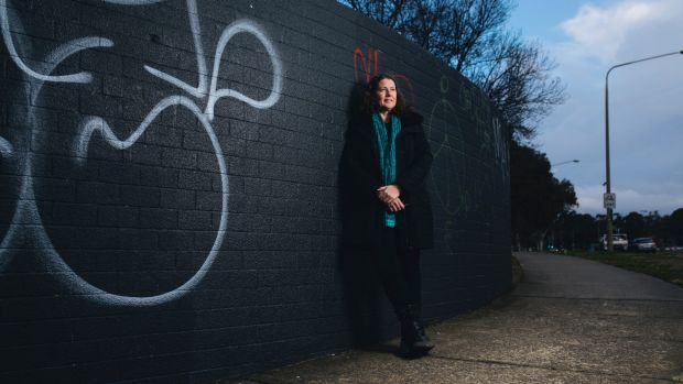 Woden Valley Community Council president Fiona Carrick in front of a wall facing Melrose Dr that is set to become a ...