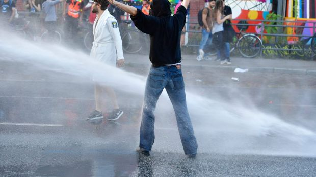 Protesters run the gauntlet of the water cannons.