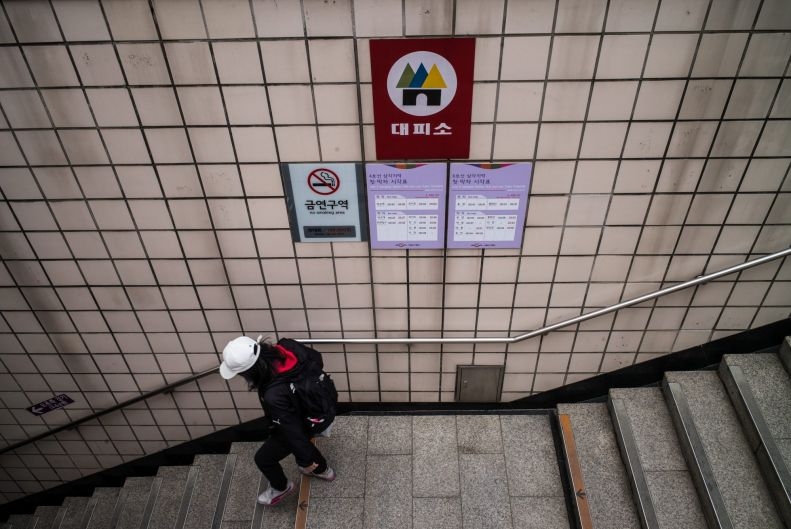 A sign pointing to a bomb shelter in Seoul, South Korea.