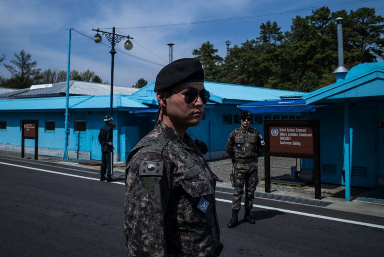 Soldiers stand guard outside the meeting rooms that straddle the border between the North and South Korea in the ...