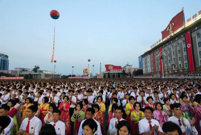 People gather in Kim Il Sung Square in Pyongyang, North Korea, to celebrate the test launch of North Korea's first ...
