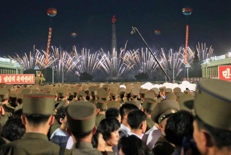 Soldiers and residents watch fireworks in Kim Il Sung Square in Pyongyang, North Korea, as they celebrate the test ...
