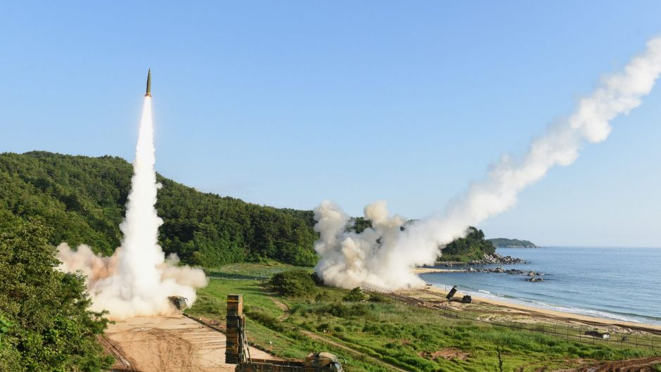South Korea's Hyunmoo-2A (L) and the U.S. Eighth Army's ATACMS missiles are fired simultaneously during a joint missile ...
