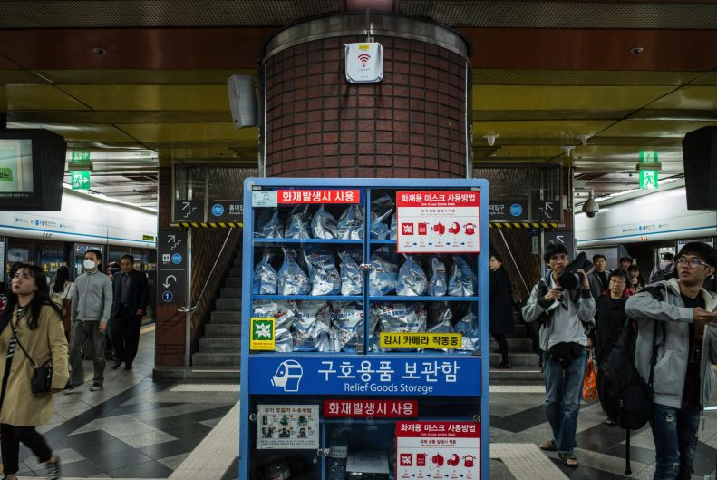 Gas masks in accessible storage at the Seoul Rail Station.