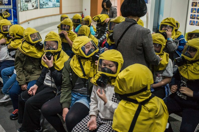 Students learn to use gas masks in case of an event of chemical or biological attacks in Seoul.
