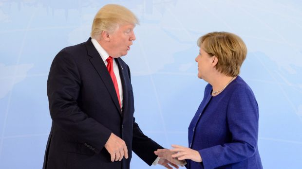 German Chancellor Angela Merkel receives US President Donald Trump in the Hotel Atlantic, on the eve of the G20 summit, ...