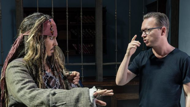 Johnny Depp as Captain Jack Sparrow with director Espen Sandberg on the set of Pirates of the Caribbean: Dead Men Tell ...