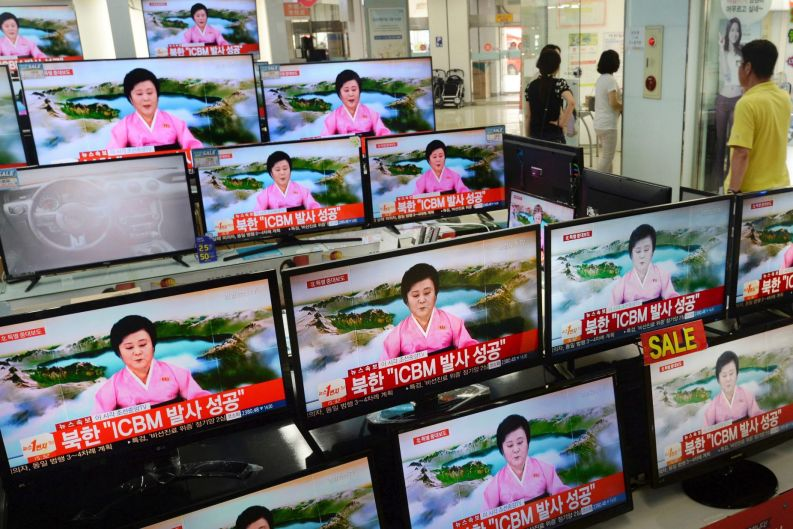 TV screens at a Yongsan Electronic shop show a North Korean newscaster reading a public announcement at in Seoul, South ...