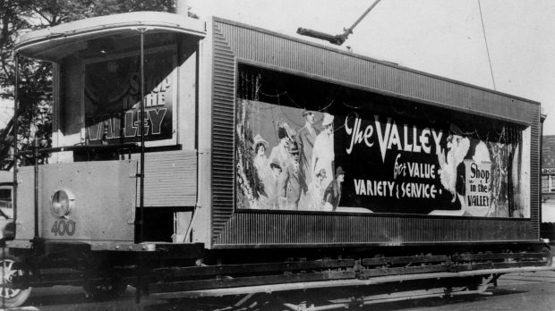 Brisbane tram featuring advertisement for Fortitude Valley shopping.