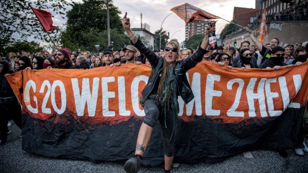 """Demonstrators attend the """"Welcome to Hell"""" anti-G20 protest march near Hamburg harbour on July 6."""