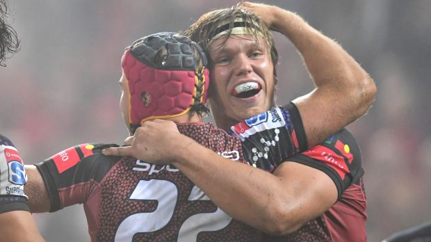 Hamish Stewart (left) of the Reds celebrates after scoring a try with teammate Adam Korczyk.