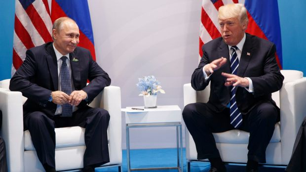 US President Donald Trump speaks during a meeting with Russian President Vladimir Putin at the G20 Summit in Hamburg on ...