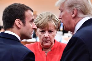 France's Emmanuel Macron, Germany's Angela Merkel and US President Donald Trump engage in conversation at the start of ...