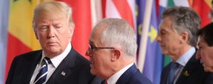 Australian Prime Minister Malcolm Turnbull walks with US President Donald Trump to the family photo during the G20 ...