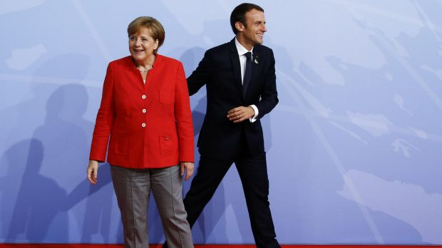 German Chancellor Angela Merkel and French President Emmanuel Macron upon his arrival at the G20.