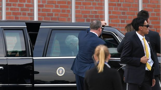 Australian Prime Minister Malcolm Turnbull can be seen entering US President Donald Trump's car, known as the 'Beast' in ...