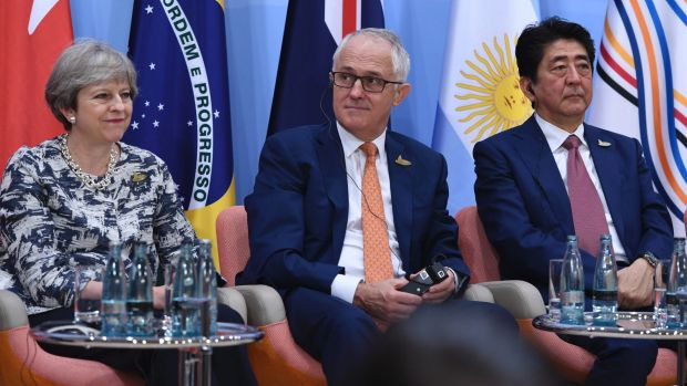 Malcolm Turnbull with Britain's Prime Minister Theresa May and Japan's Prime Minister Shinzo Abe at the G20 Summit in ...
