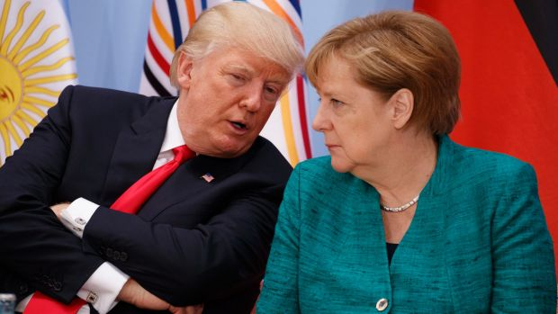 US President Donald Trump talks with German Chancellor Angela Merkel at the G20 Summit on Saturday.
