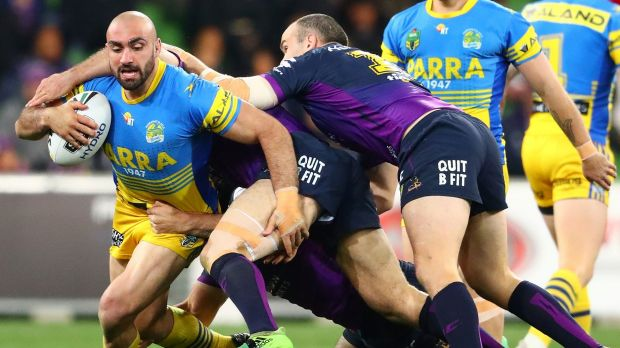 Up the middle: Tim Mannah brings the ball forward.