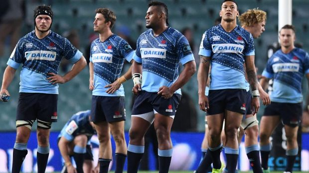 Faces tell the story: The Waratahs contemplate defeat to the Jaguares last weekend.