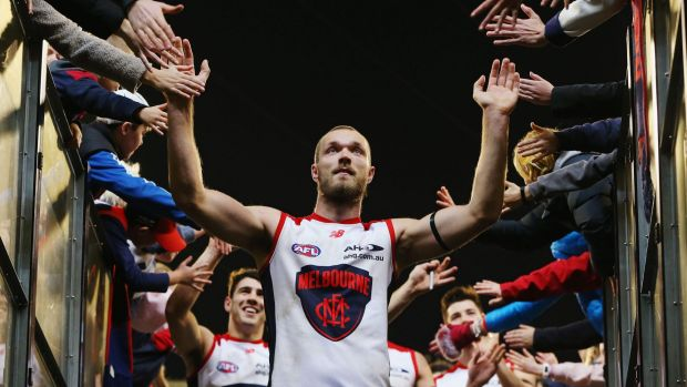 Tapping out: Max Gawn celebrates with fans at the MCG.