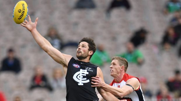 Up for grabs: Carlton's Levi Casboult tussles with Sam Frost.