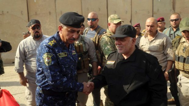 Iraqi Prime Minister Haider al-Abadi, right, shakes hands with Lieutenant-General Raid Shaker Jawlat upon his arrival in ...