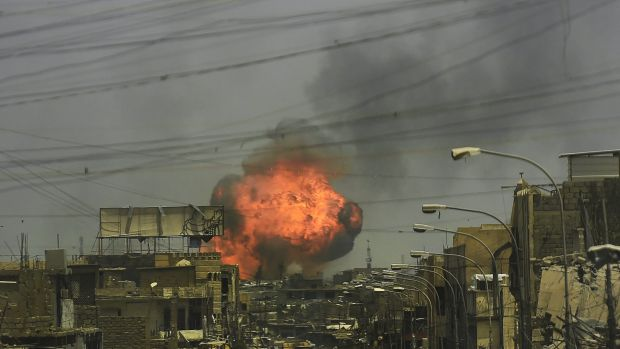A fireball explodes in the air above the shattered streets of west Mosul on July 3.