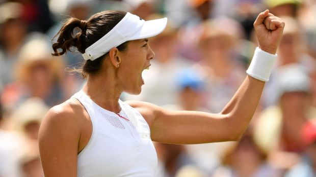 Spain's Garbine Muguruza celebrates after beating Angelique Kerber.