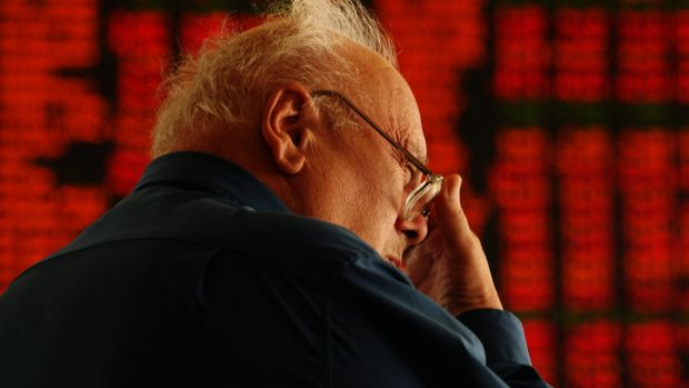 ASX. Inside the foyer of The Australian Stock Exchange and a day when the all ordinaries took a plunge. Here a man ...