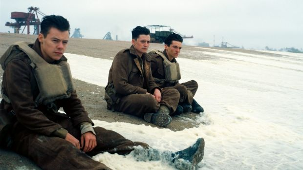 Harry Styles, Aneurin Barnard and Fionn Whitehead in a scene from Dunkirk.