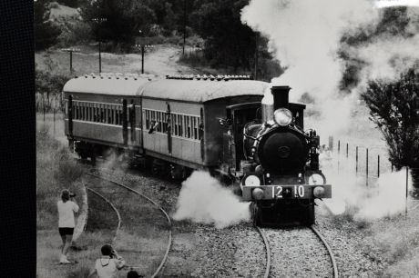 Train enthusiasts take photos of the 1210, pride of the Canberra Rail Museum's fleet, leaves the Tuggeranong siding in ...