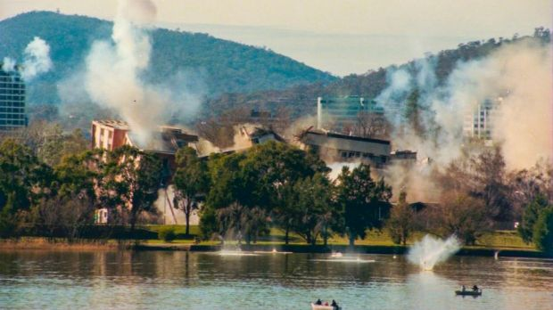 The implosion of the Royal Canberra Hospital as captured by a Canberra Times' photographer, showing debris hitting the water.
