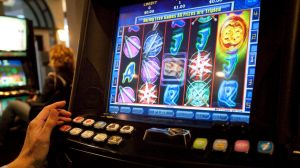 Tasmania would join Western Australia in banning pokies outside casinos under Labor's plan.