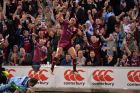BRISBANE, AUSTRALIA - JULY 12: Valentine Homes of the Maroons celebrates after scoring a try during game three of the ...