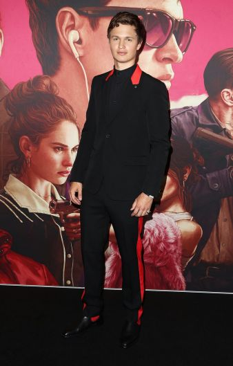 Ansel Elgort in a black and red leather trim Givenchy suit on the black carpet for the Baby Driver Australian premiere ...