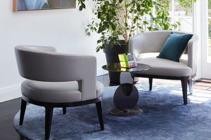 Rugs and stylish chairs go a long way to successfully furnishing a home that belongs to someone else.