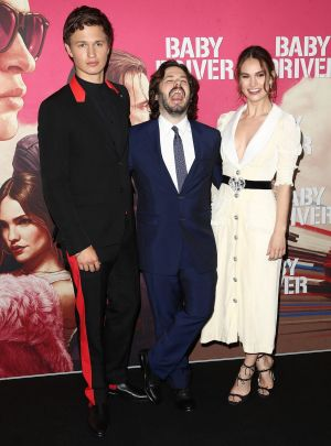 Elgort with director Edgar Wright and Lily James on the black carpet in Sydney.