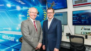 Gold Coast Commonwealth Games organising committee chairman Peter Beattie with CISCO Australia vice-president Ken Boal.