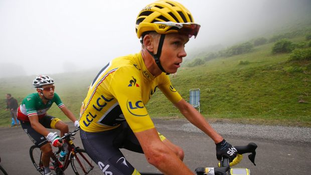 Chris Froome holds a slender lead in the Tour de France